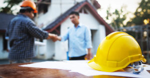 Contractor and homeowner shaking hands