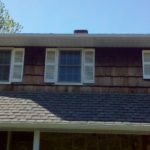 before construction photo showing old and rotten wood shingle on home
