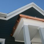 after construction photo showing the copper six inch half round gutters