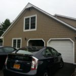 after construction photo showing shingle, windows and garage
