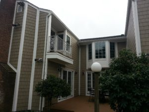 after construction photo of deck and second story balcony, side view